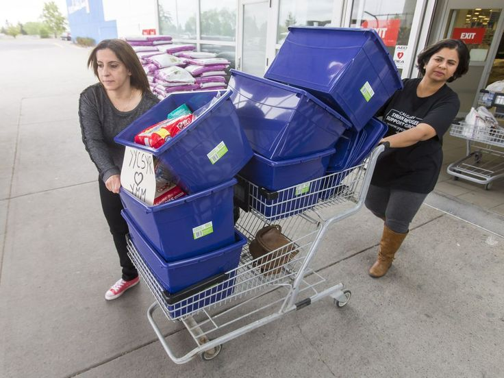 Fort McMurray Wildfire: Syrian refugees in Calgary pitch in to help | Calgary Herald