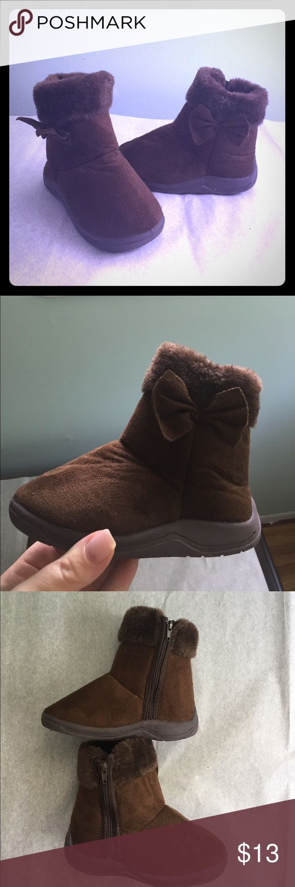 """Toddler winter boots NWOT Never worn! Bought at end of season but my daughter grew two sizes so these never fit. Box was thrown away when we moved. Adorable booties with side bow and inside zip for easy wear. See last photo as there is a small spot where the """"fur"""" is missing but it's on inside and isn't noticeable when worn. If you sew you could stitch it up but I'm not very handy with needle and thread 😋 Shoes Boots"""