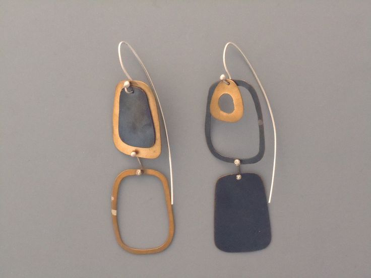 Handmade jewelry. Brass, sterling silver and blackened copper drop earrings. Modern. via Etsy.