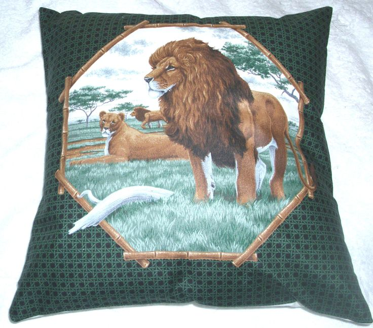 On Safari  Lions and Lioness on a  grassy plain cushion by fabricitems on Etsy