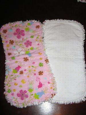 Burp cloths -- batting sandwiched between two layers of flannel with a rag edge -- link has template & tutorial