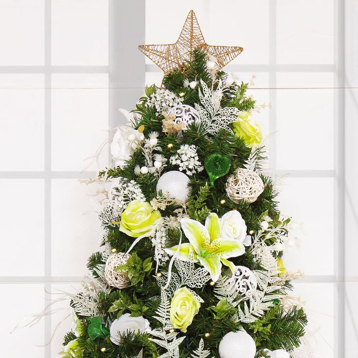 The worlds simplest pre-lit and pre-decorated Christmas Tree. Celebrate the wintery, blustering holiday season in the Rose Garden Collection and feel the love