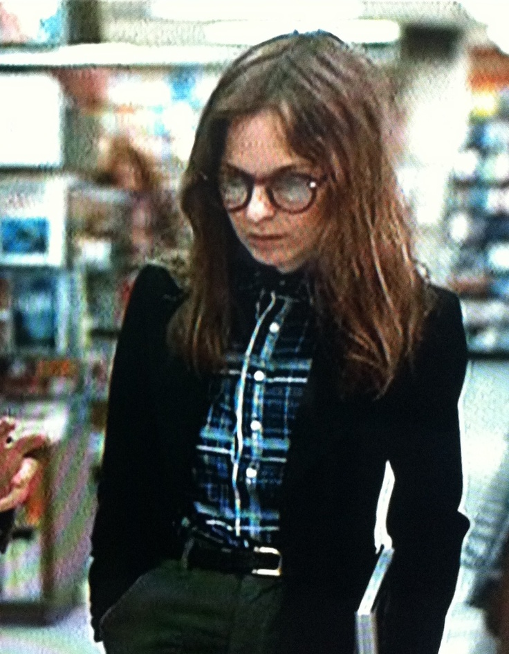 Annie Hall in olive pants, navy plaid and blac velvet jacket