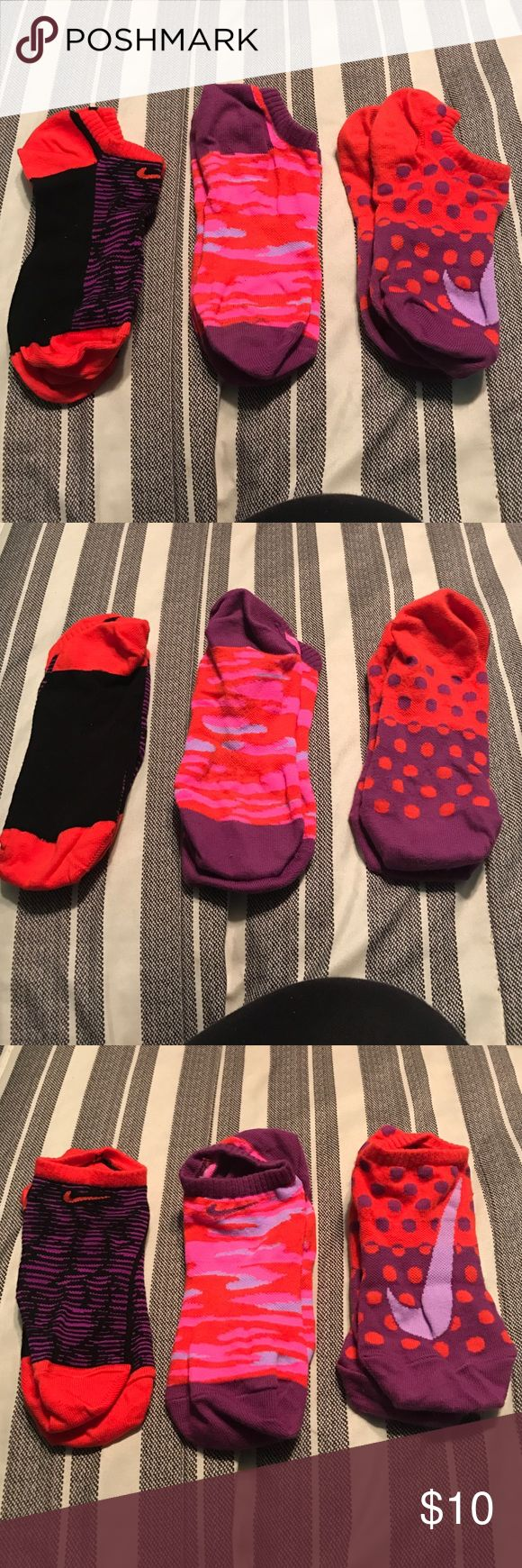 Nike socks 3 pair of Nike socks! The tags are not on but they were NEVER worn. Fits women's 5-8 Nike Accessories Hosiery & Socks