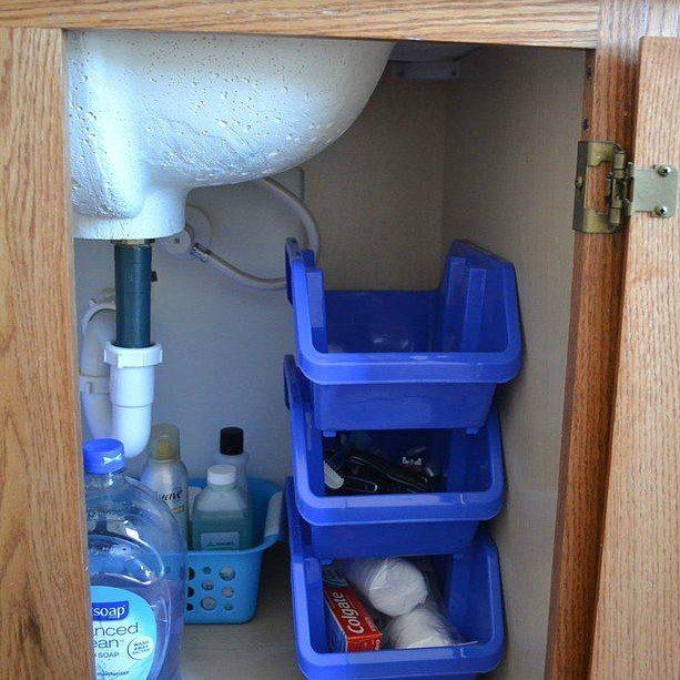 s here are 10 genius organizing ideas using dollar store bins baskets, organizing, storage ideas, Stack them up for under sink storage