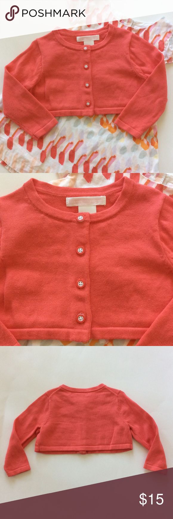 👫Janie and Jack cardigan sweater 👫Janie and Jack cardigan sweater. Gorgeous coral color. Button front. Long sleeves. 100% cotton. Size 12-18 mths. Excellent condition. Coordinates with JJ dress also listed in my closet. Janie and Jack Shirts & Tops Sweaters