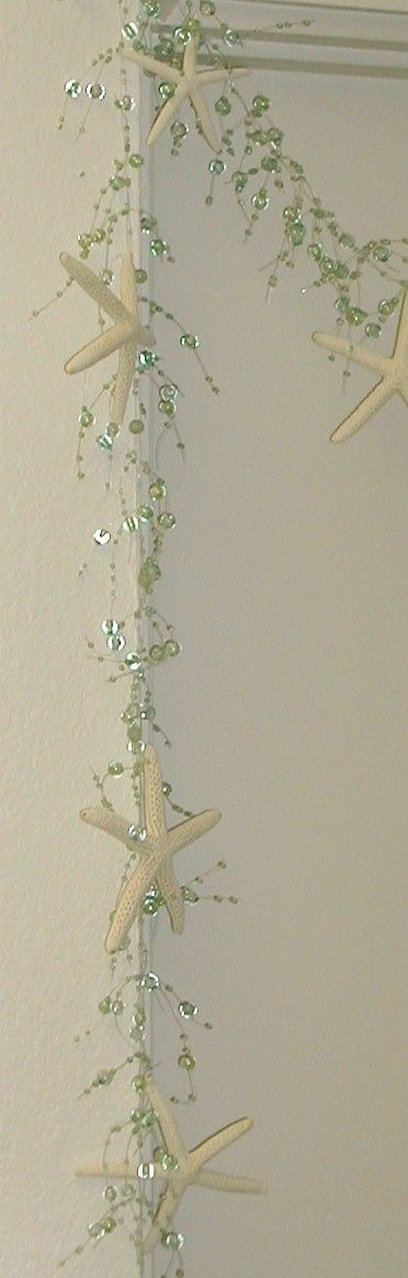 Starfish Garland Beach Decor -  Aqua with Starfish; just the beaded garland is also available online; it would be good draped around a candleholder or running through a centerpiece