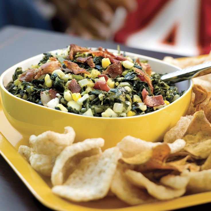 For the ultimate Southern-style warm dip, combine chopped greens, corn, and bacon and serve with pork skins, sweet potato chips and hot...