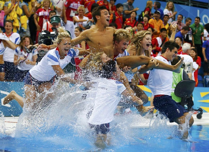 Tom Daley, center, is thrown into the pool by the British diving team after he won the bronze medal in the men's 10m platform final. London 2012 Olympics I NBC News