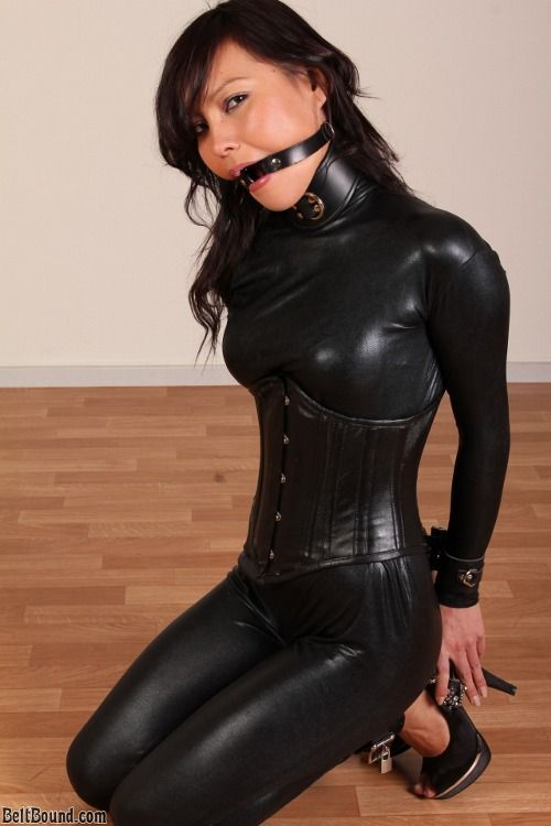 Leather caption female bondage