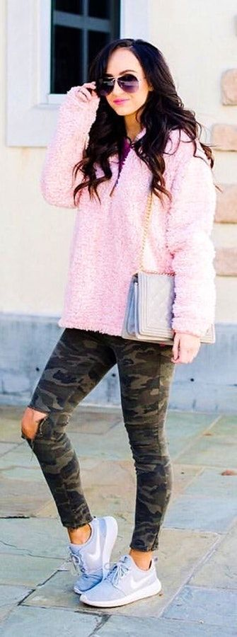 Woman wearing pink fuzzy jacket and distressed green and black camouflage jeans. #Spring #Outfit #Women #Fashion #SpringFashion #SpringOutfit