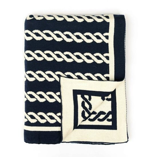 We were instantly drawn to this beach home inspired Navy Nautico Knit Throw, created in navy blue and off-white with a nautical themed rope design.