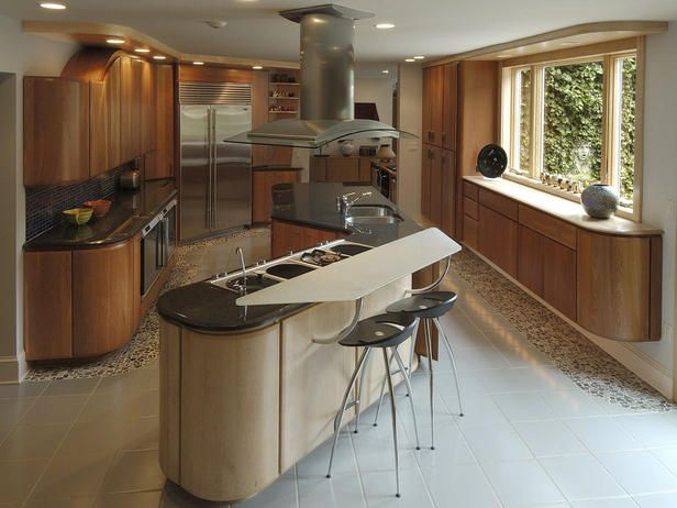 Dave Stimmel kitchen. Don't like color but elements interesting esp curves. Note floor appears to be shadowed w/use of diff tiles. To me, this would be much cuter w/fun colors (childish but way cute)!