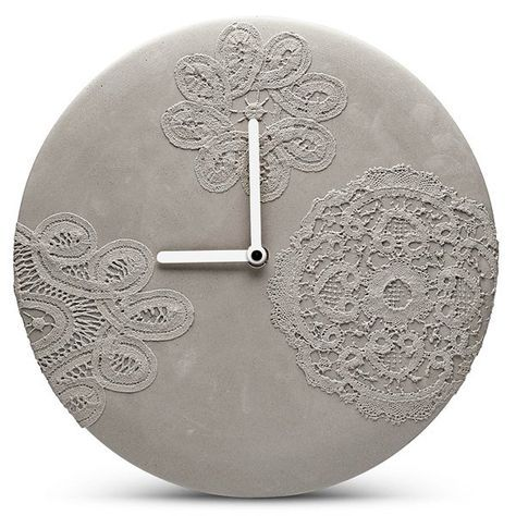 Concrete wall clock with lace pattern