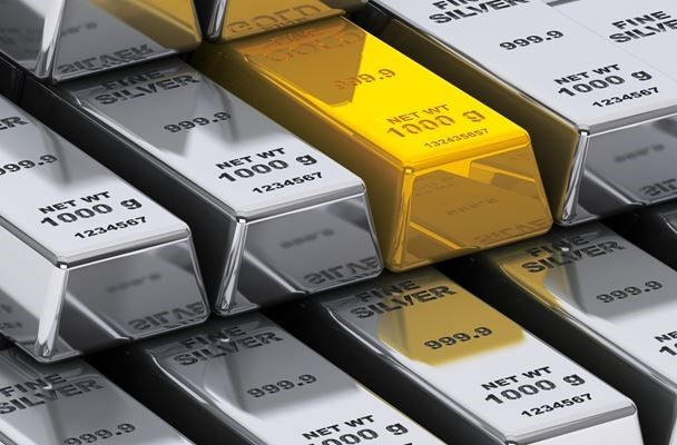 Gold and silver hurt by March rate-hike prospects, oil wobbles
