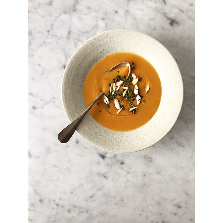 Chilled carrot soup with spices, almonds and mint