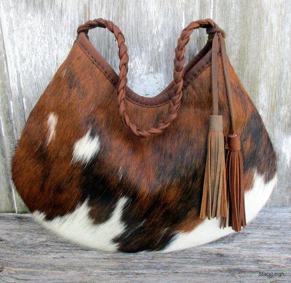 Pelo en piel de vaca cuero Hobo bolso con borlas marrón por