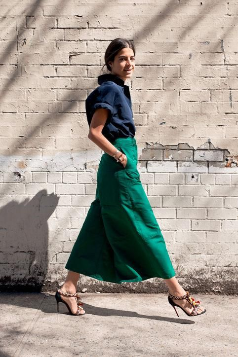 Leandra Medine of Man Repeller in green culottes and a navy shirt