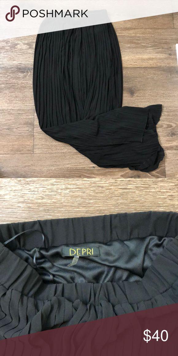 Black maxi skirt Full length (medium but fits like a size small) black pleated maxi skirt  Worn once DEPRI Skirts Maxi
