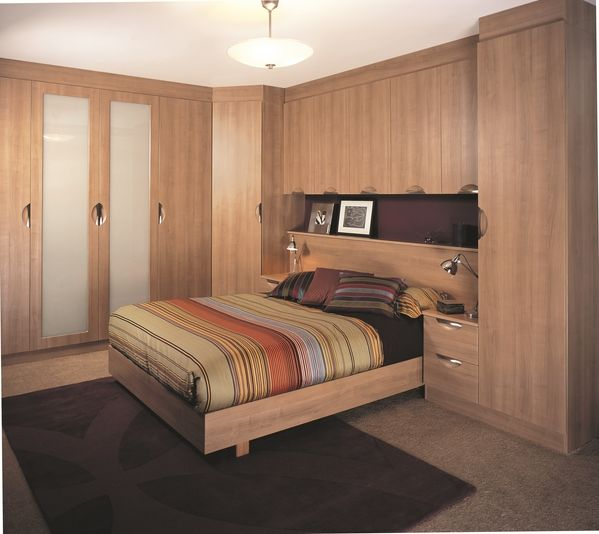 The scooped handles makes the Portofino Cherry bedroom design a practical urban look.