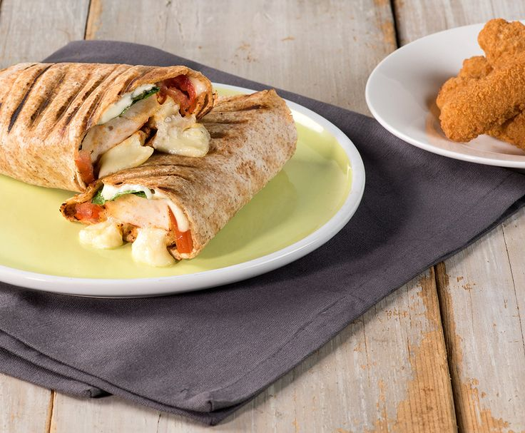 Looking for an easy, guilt-free meal? Grilled Mozzarella and Tomato Turkey Burger Wraps pack the protein and are under 500 calories. Yes, please!