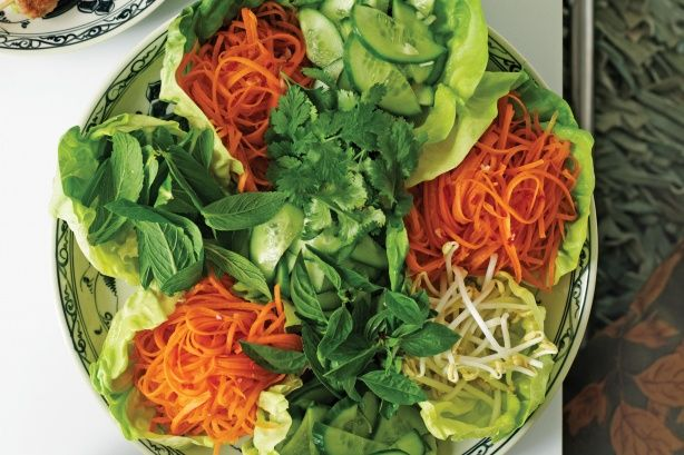 A platter of lettuce, crisp vegetables and aromatic herbs is an essential accompaniment to every traditional Vietnamese meal.