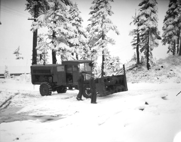 Specially designed snow clearing tractor cleared the first road up to the former Tyee Ski Club atop Grouse Mountain. The road, built in 1929, now forms part of the main ski run at Grouse.