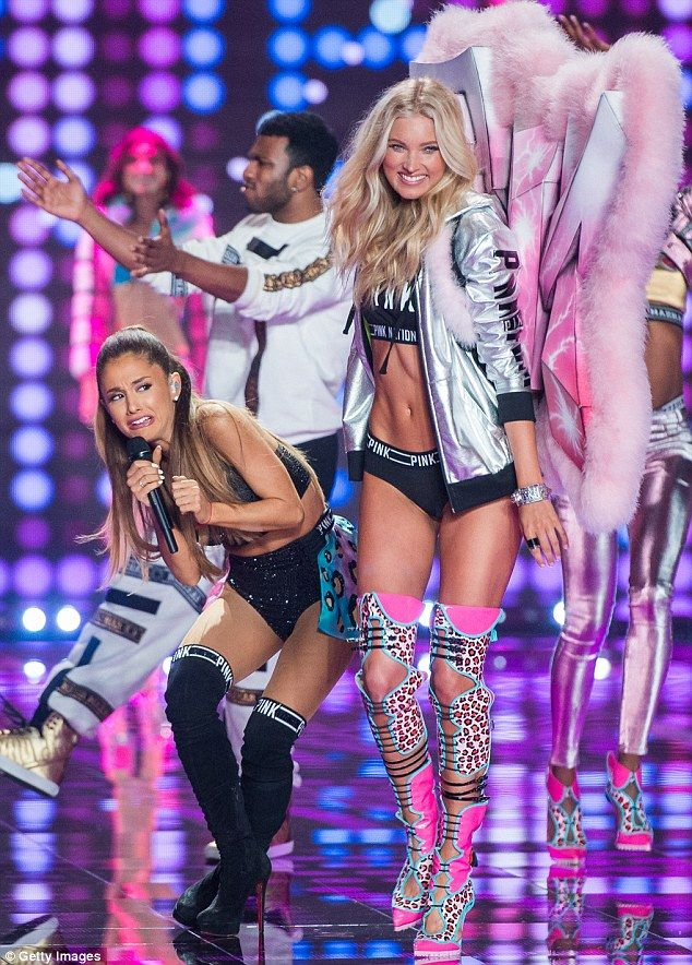Those Angels ARE scary! Watch out! Ariana Grande ducks as a Elsa Hosk's wings nearly whacks her in the face during the runway show