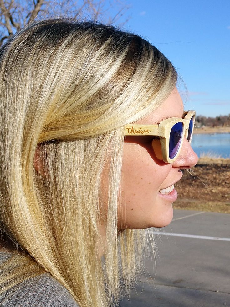 Bamboo wood sunglasses in Flourish Blue. One tree planted for each sale! www.thriveshades.com