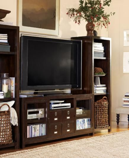 Our entertainment center - loving the big baskets for blanket storage