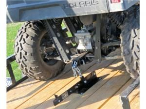 The rear components of the Mighty Tite kit feature a slotted receiver hitch, a chain, and a lever that pulls down on the machines suspension. When compressed, a locking pin keeps everything in place.
