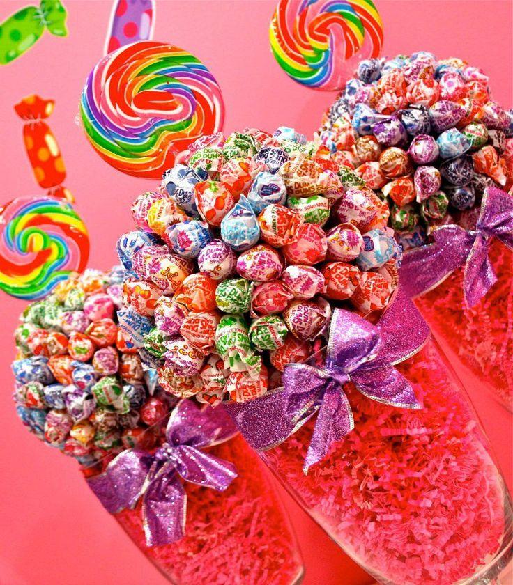 Perfect for kid's lounge, right?Dum Dum Lollipop Sucker Candy Land Centerpiece Vase, Candy Buffet Decor, Candy Arrangement Wedding, Mitzvah, Party Favor, Candy Creation. $44.99, via Etsy.