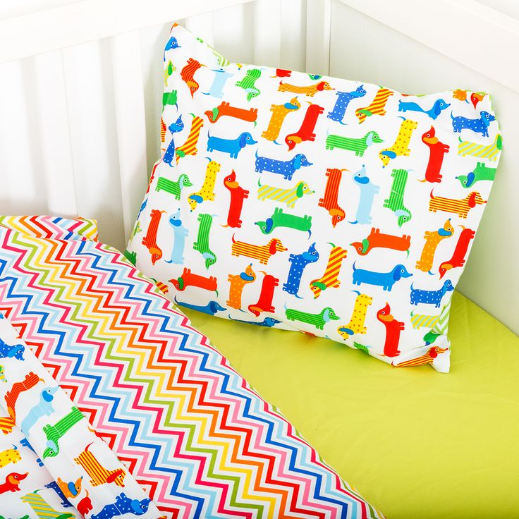 Sausage dogs in action. Colourful, happy and friendly sausage dogs will comfort your little one to sleep Soft cotton duvet cover with co-ordinated colourful zig zag materials Matching colourful zig zag pillow case and Sausage dogs resting on the front side.