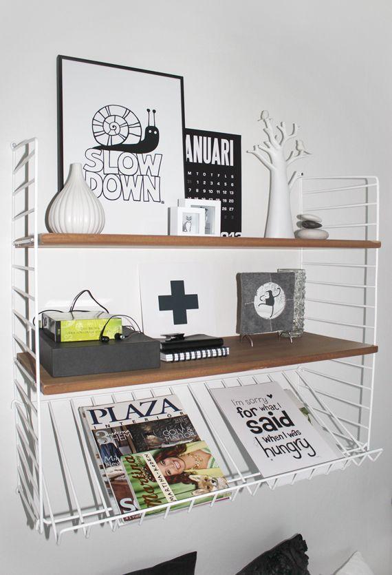 Stringhylla med tidningshållare