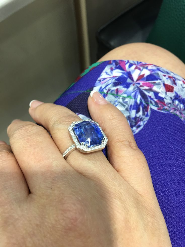 11.3 carat natural Ceylon blue sapphire in halo setting set in 18K white gold