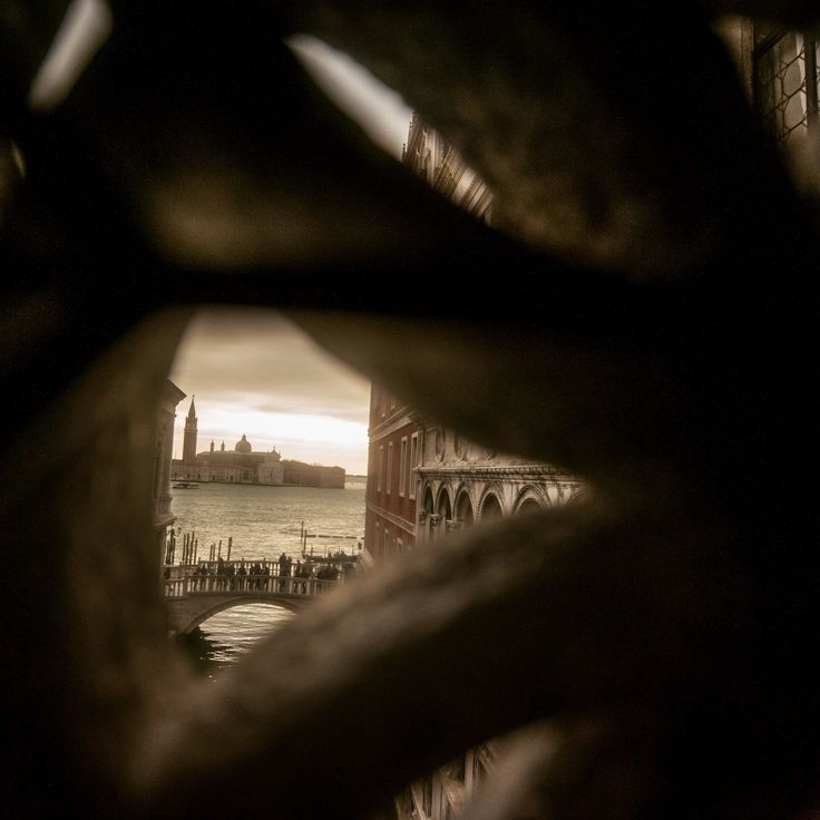 A view from the Bridge of Sighs, looking out from inside.  Watching the people watching the Bridge.  Love this view.