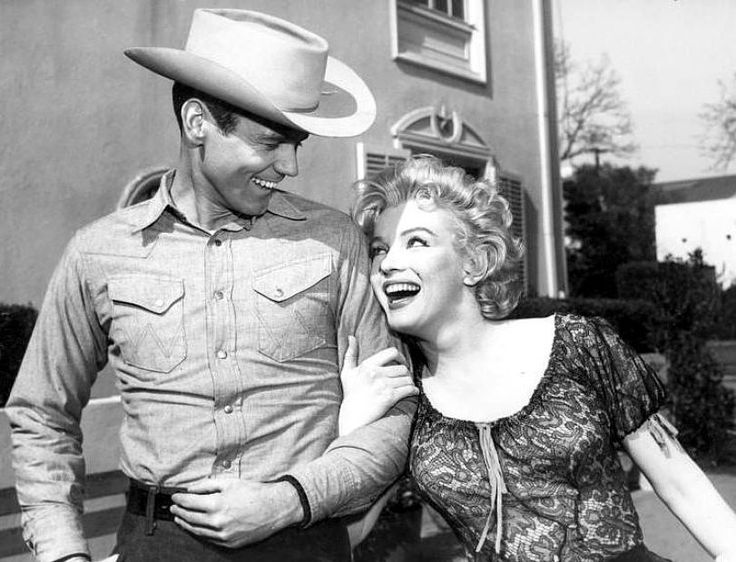 The stars of Bus Stop, Don Murray and Marilyn Monroe, enjoy each other's company.