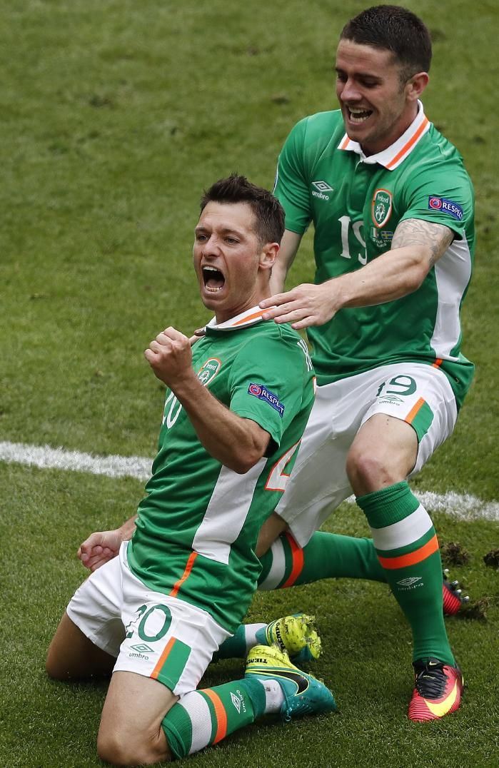 Republic of Ireland's Wes Hoolahan, right, celebrates....against Sweden