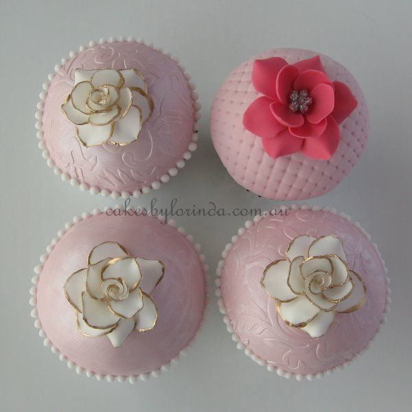 pretty pink embossed fondant cuppies with gold tipped flowers