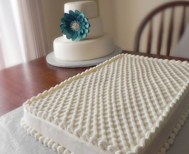 The three tiered wedding cake and two full sheet cakes served over threehundred wedding guests. Made by Sweet for the Soul in Pensacola.