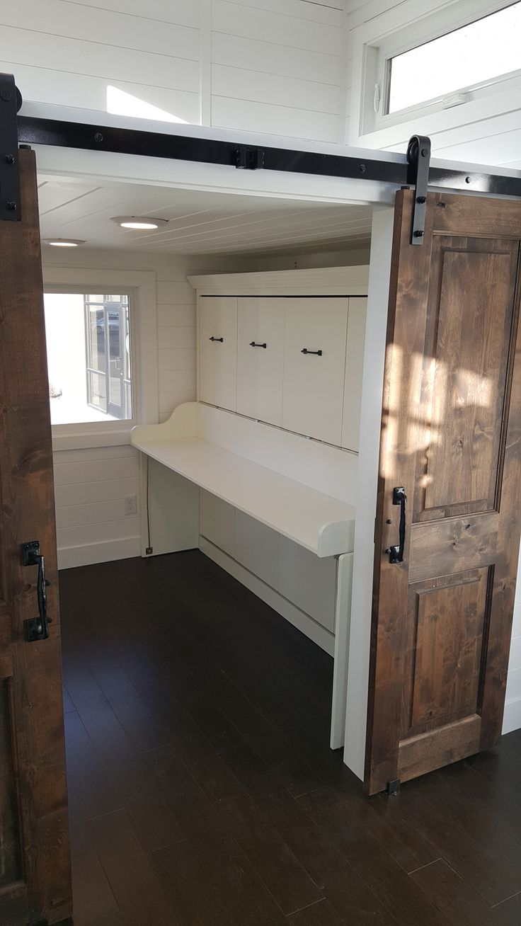 Barn Doors Lead Into The Master Bedroom Where You Ll Find Full Size Closets