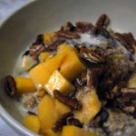 Healthy Oatmeal 1 cup cooked oatmeal  1/2 tsp cinnamon  1/4 fresh mango  2 tbsp. ground flax seed  2 tbsp. raw wheat germ  1/4 cup pecans  1/2 cup light coconut milk  1 scoop whey protein powder  1/2 tbsp. agave