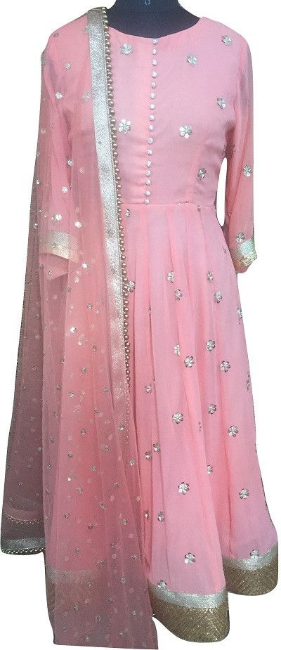 Wear anokherang's Peach Anarkali suit which has all over gold embroidery with sequence work and a light gold with antique gold border on the Ghera. This comes w