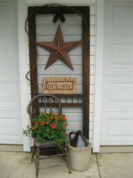 Old screen door...I like the idea of decorating between the garage doors :)