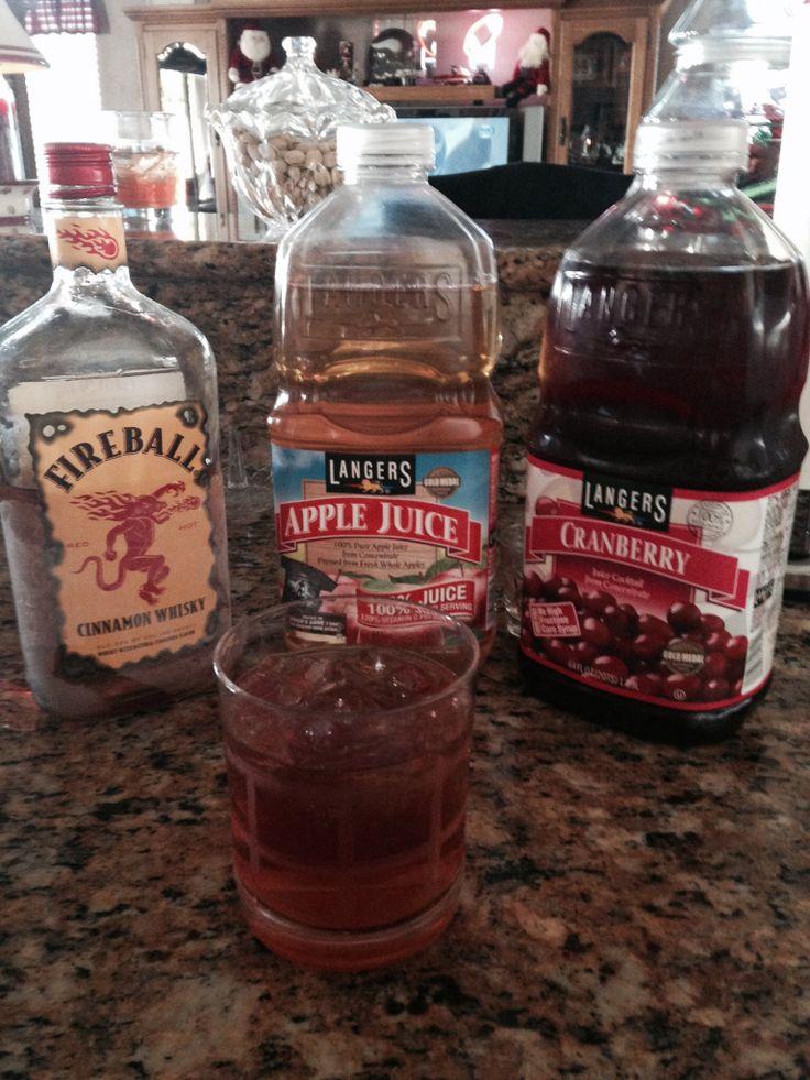 "Christmas Hug 1 part Fireball Whiskey 2 parts Apple Juice 1 part Cranberry Juice Tastes like warm apple pie, very yummy! www.LiquorList.com ""The Marketplace for Adults with Taste"" @LiquorListcom #LiquorList"