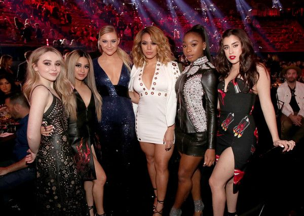 Singers Sabrina Carpenter (L) and Kelsea Ballerini (3rd from L) pose with singers (from 2nd L) Ally Brooke, Dinah Jane, Normani Kordei, and Lauren Jauregui of music group Fifth Harmony during the 2017 iHeartRadio Music Awards which broadcast live on Turner's TBS, TNT, and truTV at The Forum on March 5, 2017 in Inglewood, California. - iHeartRadio Music Awards - Show