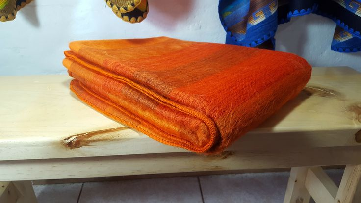 Warm and beautiful alpaca throw blanket shutter orange handmade by Ecuadorian women artisans. Brushed, soft, light, comfortable and durable.  Size: 67x92 inches Weight: 27 Ounces or 765 Grams