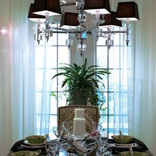 """Candice Olson Cluny 9-Light Chandelier. Crystal and chrome finish with chocolate poly silk shades. Includes 3 adjustable poles to 36"""" and nine 40W candle bases. Hand-crafted, no two are alike."""