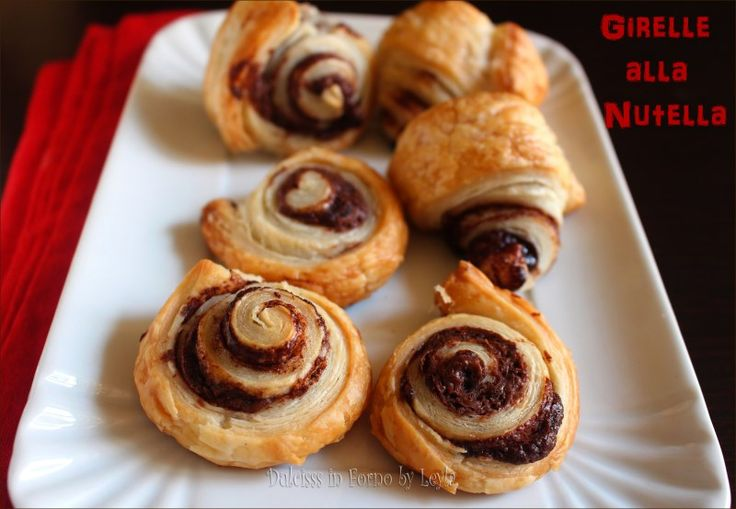 Una ricetta superfacile e superveloce per creare dei piccoli dolcetti di pasta sfoglia e nutella: le Girelle alla nutella o Sfogliatine alla nutella.
