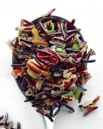 Toss toasted pecans and dried cherries or cranberries with cooked wild rice to make this hearty pilaf. Scallions and red-wine vinegar add zing to the dish.